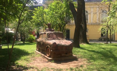 Monument of communism with the legendary Trabant